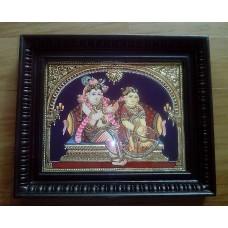 Krishna Plaiting Radha Hair